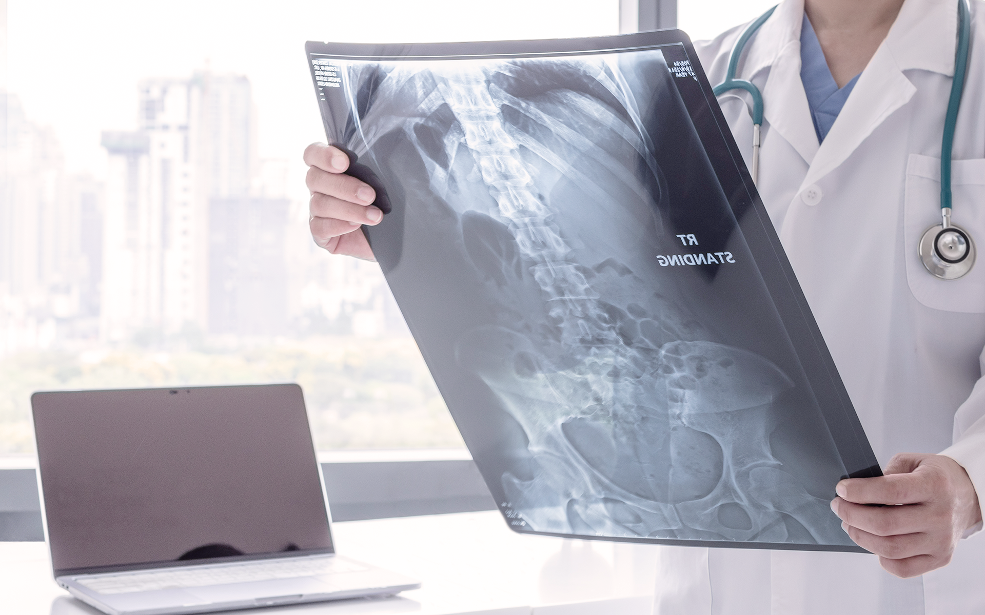 Doctor looks at an x-ray at a radiology center.