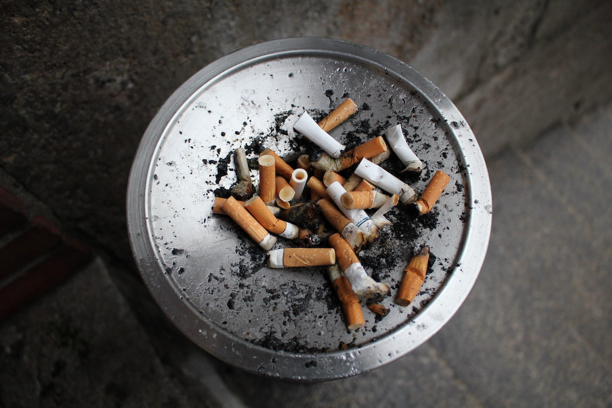 tray full of cigarette butts and ash from daily smoker