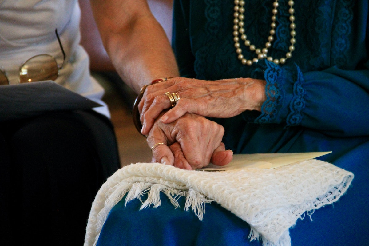caregiver holding hands with veteran