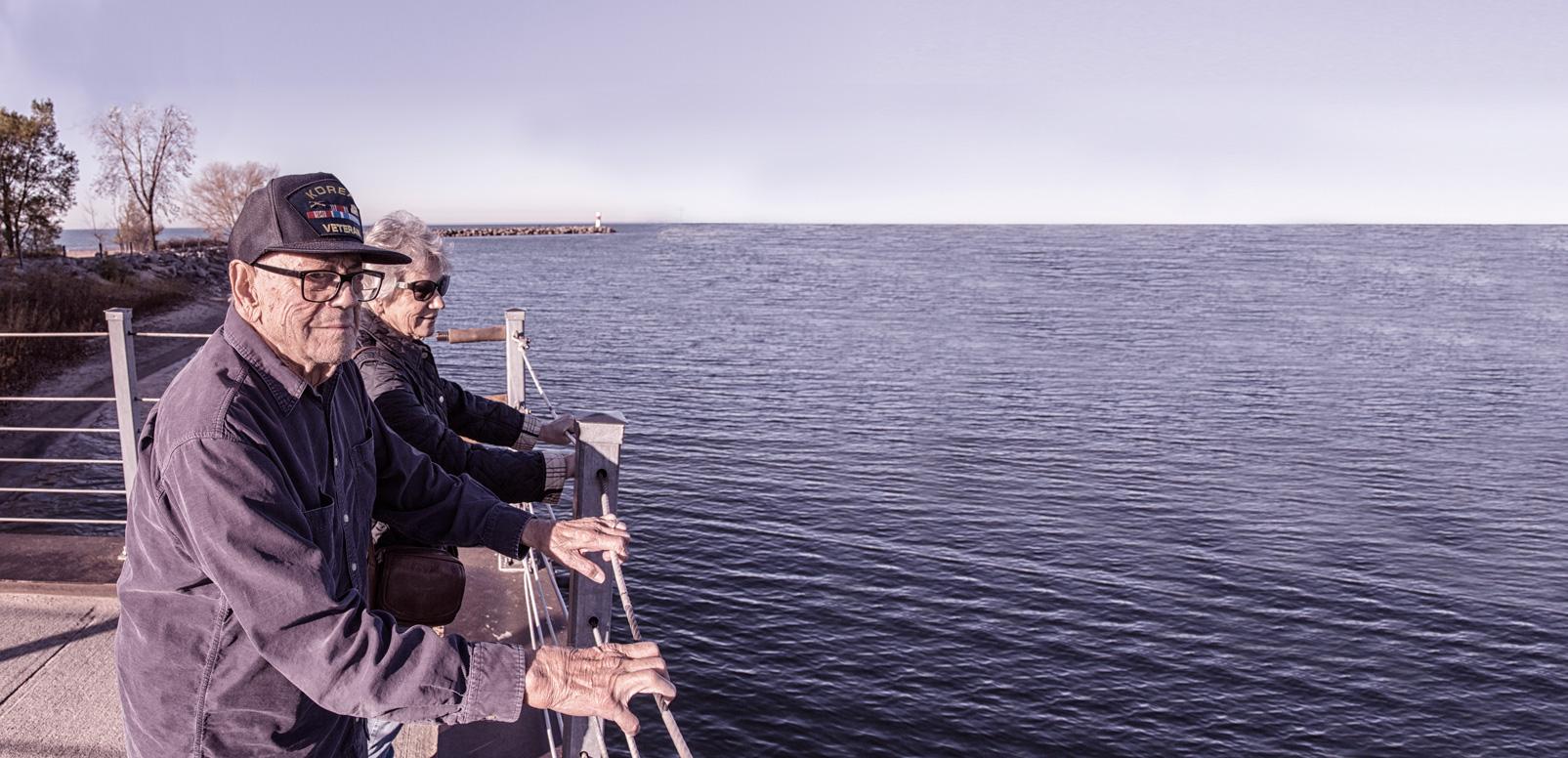 Korean War Veteran and his wife overlooking the ocean