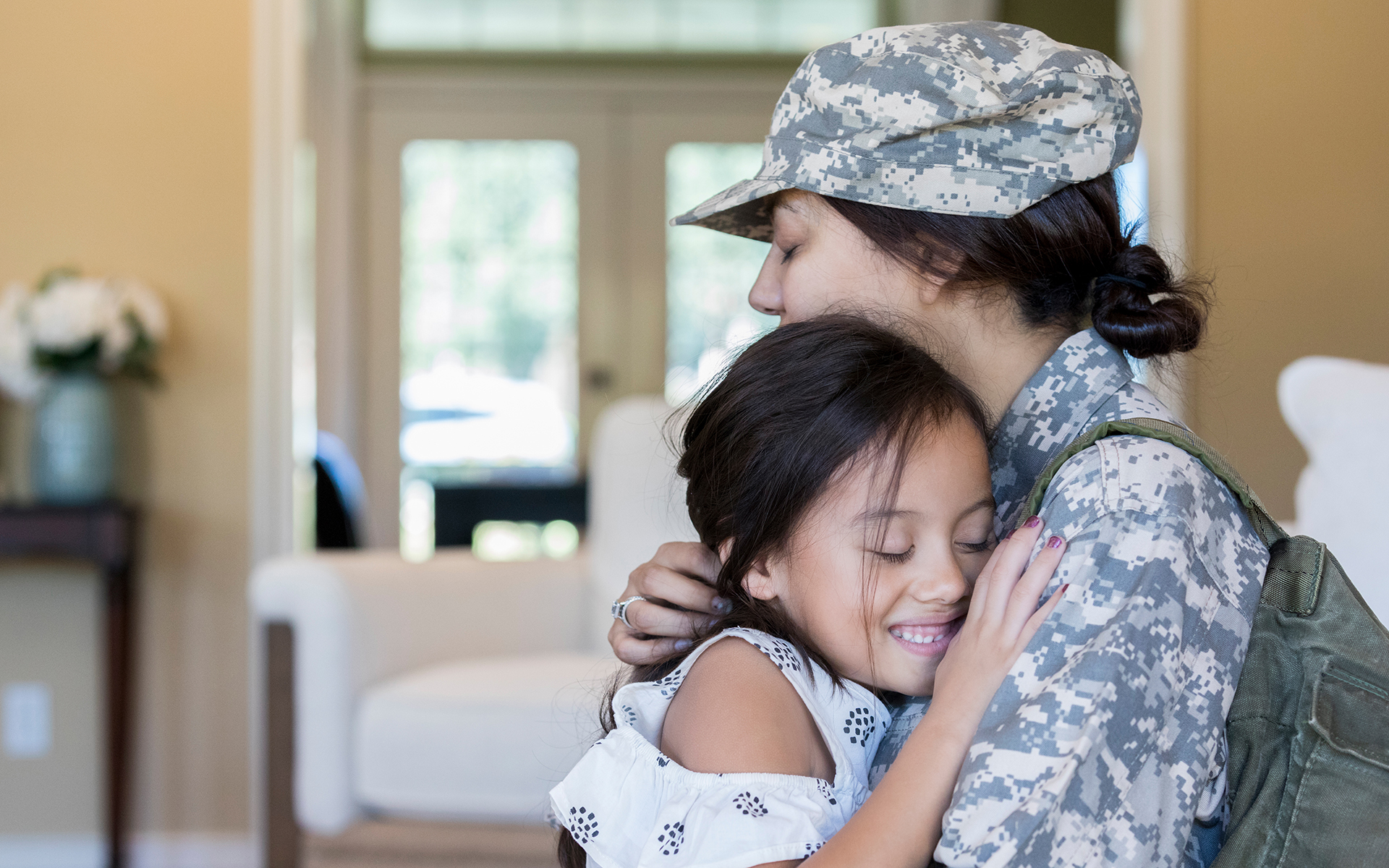 A veteran and her child having a loving embrace.