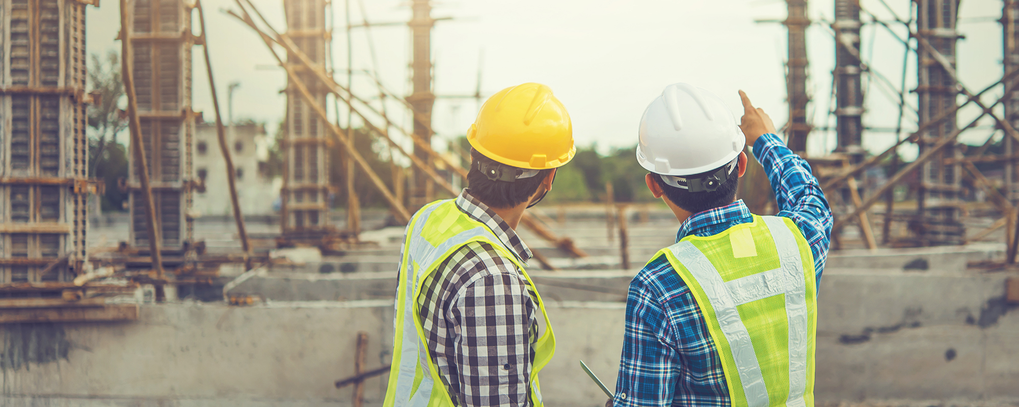 Two construction workers discussing the project ahead.