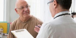 Veteran talking to VA doctor.